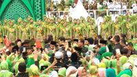 Presiden Jokowi menghadiri Harlah ke-73 Muslimah NU di GBK, Jakarta. (Liputan6.com/Putu Merta Surta Putra)