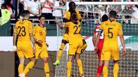 Timnas Australia menang 3-0 atas Palestina pada laga kedua Grup B Piala AFC 2019, di Rashid Stadium, Dubai, Jumat (11/1/2019). (AFP/Karim Sahib)
