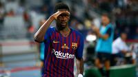 Gelandang Barcelona, Ousmane Dembele berselebrasi usai mencetak gol ke gawang Sevilla dalam Piala Super Spanyol di Tangier, Maroko, (13/8). Barcelona meraih gelar ke-13 di Piala Super Spanyol terbanyak ketimbang tim lain. (AP Photo/Mosa'ab Elshamy)