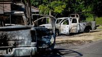 Kendaraan polisi Meksiko yang dibakar selama penyergapan. (AFP)