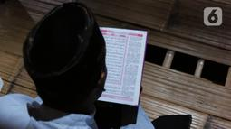 Aldi yang berganti nama muslim menjadi Hamid Bambang Kusomo (28) saat ditemui di pemukiman mualaf yang berbatasan dengan daerah adat Baduy. Aldi mengaku memeluk Islam setelah mendatangi pemukiman mualaf yang tidak jauh dari Baduy luar. (Liputan6.com/Herman Zakharia)