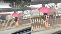 Aksi Siswi Gendong Teman Penyandang Autisme di Tengah Hujan (sumber: worldofbuzz)