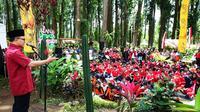 Pemkab Banyuwangi, Jawa Timur, menggelar Kemah Kebangsaan yang berlangsung di Wana Wisata Sumbermanis, Gombengsari, Kecamatan Kalipuro. (Liputan6.com/Dian Kurniawan)