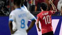 Winger Timnas Mesir, Mohamed Salah, berhasil mencetak satu gol sekaligus membantu timnya menang 2-0 atas Kongo pada laga kedua Grup A Piala Afrika 2019, Rabu (26/6/2019). (AFP/Javier Soriano)