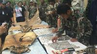 Kepolisian Thailand membongkar upaya penyelundupan sejumlah macan dan bagian-bagian tubuh hewan itu di sebuah biara. (Sumber Bangkok Post)
