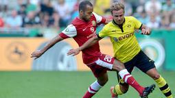 Bersama Dortmund, Mario Gotze berhasil melambungkan namanya. Dirinya sukses membawa Dortmund dua kali gelar Bundesliga. (AFP/Carmen Jaspersen)