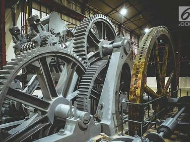 Sebuah mesin terlihat di dalam Pabrik Gula Colomadu yang berganti nama menjadi De Tjolomadoe di Karanganyar, Jawa Tengah. PT PP (Persero) Tbk telah merampungkan restorasi PG atau Pabrik Gula tersebut. (Liputan6.com/Pool/BUMN)