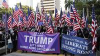 Demonstrasi digelar untuk berterima kasih kepada anggota parlemen dan presiden AS Donald Trump atas dukungannya pada Hong Kong. (AFP)