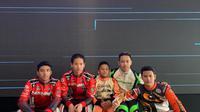 Pegokart Qarrar Firhand Ali (tengah) berhasil merebut juara di kelas little rocker di kejuaraan Rok Asia Zone 4 di Singapura (istimewa)