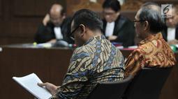 Terdakwa Irvanto Hendra Pambudi yang juga keponakan Setya Novanto dan Made Oka Masagung menjalani sidang perdana kasus fee korupsi e-KTP di Pengadilan Tipikor, Jakarta, Senin (30/7). (Merdeka.com/Iqbal S Nugroho)