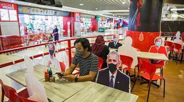 Restoran ini Gunakan Gambar Kepala Negara untuk Terapkan Protokol Kesehatan