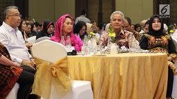 Menteri Desa PDTT Eko Putro Sandjojo (kiri) bersama Gubernur Jateng Ganjar Pranowo (dua kanan) dan Co-Founder Wahid Fondation Yenny Wahid (dua kiri) saat menghadiri Forum Nusantara bersama UN Women, Jakarta, Jumat (8/2). (Liputan6.com/JohanTallo)