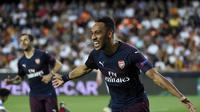 Pierre-Emerick Aubameyang mencetak tiga gol untuk Arsenal pada saat menghadapi Valencia di Liga Europa. (AFP/Jose Jordan)