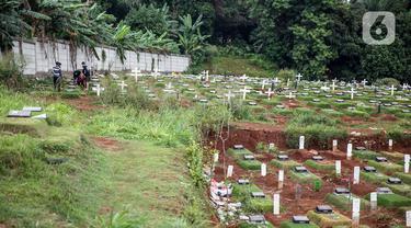 FOTO: Penuh, Begini Kondisi Pemakaman Khusus Jenazah dengan Protokol COVID-19 di TPU Pondok Ranggon