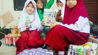 Andi Nisfatil Aira, aktivis cilik lingkungan. Menjadi virus peduli lingkungan di sekolahnya. (foto: Liputan6.com /ahmad Yusran)
