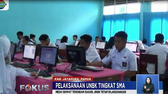 Di Sentani, Papua, meski gedung sekolah sempat tersendam banjir bandang beberapa waktu lalu, namun hari ini pelaksaan UNBK bisa diadakan.