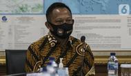 Menteri Dalam Negeri Tito Karnavian saat mengunjungi Kantor KPU, Jakarta, Kamis (30/7/2020). Kunjungan Tito Karnavian dalam rangka membahas pelaksanaan Pemilihan Serentak 2020. (Liputan6.com/Johan Tallo)