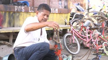Pengepul Sepeda Rongsok Sanudi Rahul