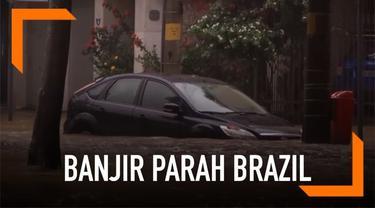 Hujan lebat yang terjadi terus menerus di Brazil sebabkan banjir besar yang sebabkan sedikitnya 10 warga Brazil tewas.