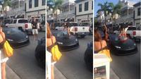 Mencoba bergaya mengendarai Lamborghini Huracan, pria ini justru pecahkan kaca. (Carscoops)