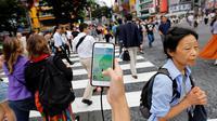 Jalan-jalan di Jepang diramaikan para pemain Pokemon Go (Foto: Business Insider)
