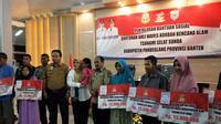 Para perwakilan keluarga korban Tsunami Selat Sunda yang mendapatkan bantuan dari Kemensos (Liputan6.com / Nefri Inge)