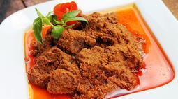 Ilustrasi masakan rendang khas Sumatra Barat