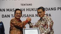 Direktur Kepatuhan, Hukum, dan Hubungan Antar Lembaga BPJS Kesehatan Bayu Wahyudi jalin kerja sama dengan Kejaksaan Tinggi DKI Jakarta. (Foto: Humas BPJS Kesehatan)