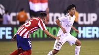 Takefusa Kubo saat beraksi untuk Real Madrid lawan Atletico (Johannes EISELE / AFP)