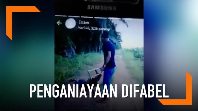 Sebuah video penganiayaan beredar di media sosial. Seorang pria menganiaya difabel. Aksi brutal ini dikecam warganet.