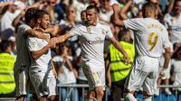 Eden Hazard mencetak gol perdana bersama Real Madrid, sekaligus membawa timnya menang 4-2 atas Granada pada laga pekan kedelapan La Liga Spanyol, di Santiago Bernabeu, Sabtu (5/10/2019). (AP Photo/Bernat Armangue)