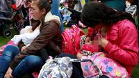 Para ibu saat menyusui bayi mereka selama memperingati Pekan ASI Dunia di Bogota, Kolombia (3/8). Aksi ini untuk mengkampanyekan pentingnya manfaat Air Susu Ibu (ASI) untuk kesehatan bayi dan balita. (REUTERS/John Vizcaino)