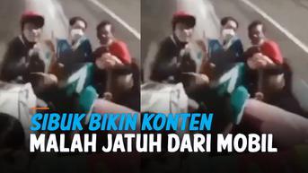 VIDEO: Asik Bikin Konten, Dua Pemuda Jatuh dari Mobil