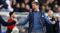 Ekspresi pelatih Hoffenheim, Julian Nagelsmann saat timnya mengalahkan Bayern Munchen pada lanjutan Bundesliga Jerman di Rhein-Neckar-Arena, Sinsheim, Selasa(4/4/2017). Hoffenheim menang 1-0. (EPA/Ronald Wittek)
