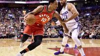 DeMar DeRozan memimpin Toronto Raptors meraih kemenangan melawan Sacramento Kings, Minggu (17/12/2017) atau Senin (18/12/2017) pagi WIB.(AP/Frank Gunn)