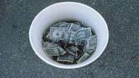 Cara bodoh buang uang (sumber. Time.com)