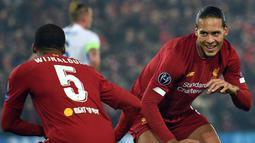 Virgil van Dijk bukanlah pemain baru Liverpool, namun banyak ditunggu penampilannya oleh para fans The Reds. Van Dijk sempat absen lama akibat cidera yang dialaminya. Dirinya banyak diharapkan akan mengembalikan kepercayaan diri Skuat Merseyside Merah. (Foto: AFP/Oli Scarff)