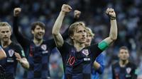 Kapten timnas Kroasia, Luka Modric, merayakan kemenangan timnya atas Argentina pada laga kedua Grup D Piala Dunia 2018, Jumat (22/6/2018) dini hari WIB. (AP Photo/Ricardo Mazalan)