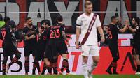 AC Milan meraih kemenangan 1-0 atas Torino pada laga pekan ke-10 Serie A di San Siro, Rabu (27/10/2021) dini hari WIB. Gol tunggal Milan dicetak Olivier Giroud pada menit ke-14. (AFP/Marco Bertorello)