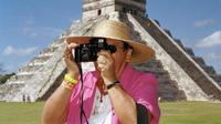 Fokus terhadap kamera dan menentukan angle foto selama liburan dapat menurunkan pengalaman dan kenikmatan liburan.