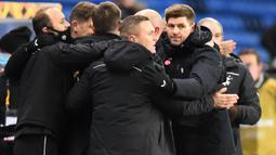 Gelandang legendaris Liverpool itu berhasil membawa anak asuhnya menjuarai Liga Skotlandia dengan tidak terkalahkan dalam 38 laga. (Photo by ANDY BUCHANAN / POOL / AFP)
