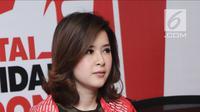 Ketua umum PSI, Grace Natalie saat menggelar konferensi pers di kantor DPP PSI, Jakarta, Jumat (1/6). Sebelumnya pada 23 April 2018, PSI memasang iklan alternatif cawapres dan Kabinet Jokowi 2019-2024 di sebuah koran. (Liputan6.com/Herman Zakharia)