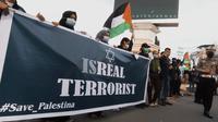 Ratusan Masyarakat Gorontalo Bentangkan Spanduk Bertuliskan Israel The Real Teroris/Foto.Istimewa (Arfandi Ibrahim/Liputan6.com)