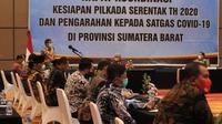 Rapat Koordinasi Kesiapan Pilkada Serentak Tahun 2020 dan Pengarahan kepada Satgas Covid-19 di Provinsi Sumatera Barat dihadiri Mendagri, Tito Karnavian. (Liputan6.com/ Novia Harlina)