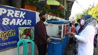 Kemnaker Serahkan Bantuan TKM kepada PKL di Jakarta (Istimewa)