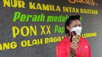 Atinna Nur Kamila Intan Bahtiar (22), warga RT 04 RW 01 Desa Pangebatan, Kecamatan Karanglewas, Banyumas, berhasil meraih medali emas sekaligus memecahkan rekor PON dan rekor nasional. (Foto: Pangebatan.desa.id)