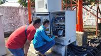 Ilustrasi proses pemulihan jaringan Telkomsel di wilayah terdampak banjir di Kecamatan Masamba, Sulawesi Utara. (Dok. Telkomsel)