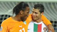 Didier Drogba dan Cristiano Ronaldo. (TOSHIFUMI KITAMURA / AFP)