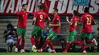 Cristiano Ronaldo berhasil mengukir hattrick saat Timnas Portugal menang 5-0 atas Luksemburg pada laga ketujuh kualifikasi Piala Dunia 2022 zona Eropa di Estadio Algarve, Faro/Loule, Rabu (13/10/2021) pagi WIB. (AFP/Carlos Costa)