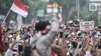 Massa dari PA 212 menuju Patung Kuda, Jakarta, untuk mengikuti aksi menolak UU Cipta Kerja, Selasa (13/10/2020). Selain PA 212, massa gabungan mahasiswa dan pelajar turut aksi mendesak Presiden Joko Widodo membatalkan UU Cipta Kerja Omnibus Law yang dinilai merugikan. (merdeka.com/Iqbal Nugroho)